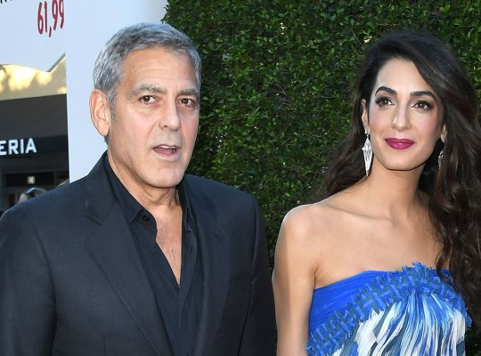 george clooney twins fatherhood flight