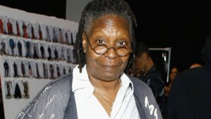 whoopi goldberg is digging her own grave with a knife fork