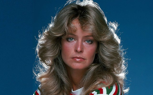 Farrah Fawcett wears a green and red stripped white shirt.
