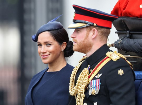 Meghan Markle in Navy Suit Dress And Blue Hat Riding in Carriage With Prince Harry in Full Uniform
