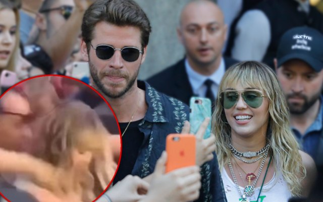 Liam Hemsworth and Miley Cyrus Walking In Spain with Inset of Fan Grabbing Miley Cyrus