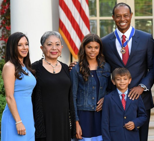 Professional golfer Tiger Woods stands with, From Left, his girlfriend Erica Herman, mother Kultida Woods, Daughter Sam Alexis Woods and son Charlie Axel Woods. Photo: Getty Images