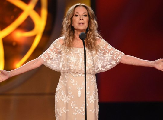 Kathy Lee Gifford Wearing White and Nude Lace Dress with Arms Spread Wide